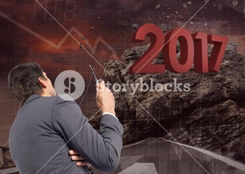 3D Composite image of 2017 with business man planning about growth