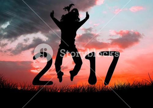 Silhouette of a jumping person forming 2017 new year sign