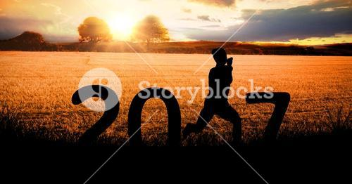 Silhouette of a running person forming 2017 new year sign