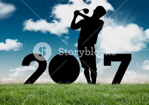 Silhouette of man playing golf forming 2017 new year sign