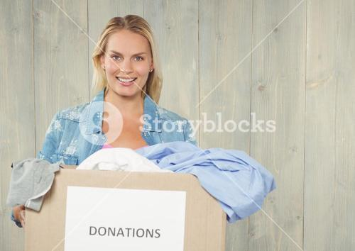 Smiling woman holding donations box