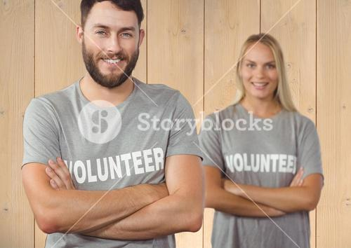 Volunteer couple standing with arms crossed