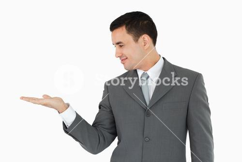 Businessman looking at his palm