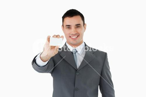 Young businessman showing his businesscard