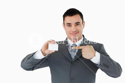 Businessman pointing at his businesscard