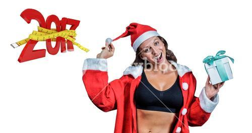 3D Composite image of portrait of female athlete in christmas costume and holding gift