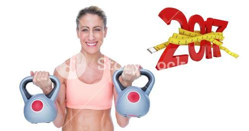 3D Composite image of smiling female crossfitter lifting kettlebells