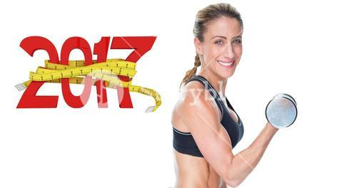 3D Composite image of female bodybuilder working out with large dumbbells smiling at camera