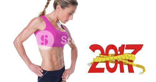 3D Composite image of female bodybuilder posing in pink sports bra