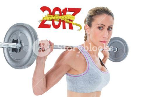 3D Composite image of strong female crossfitter lifting barbell behind head looking at camera