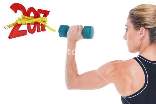 3D Composite image of female bodybuilder holding a blue dumbbell