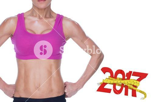3D Composite image of female bodybuilder posing in pink sports bra and shorts mid section