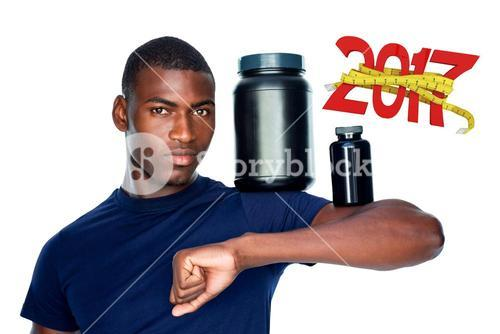 3D Composite image of fit man holding bottles with supplements on his biceps