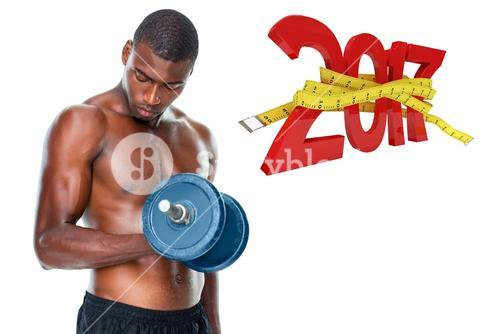 3D Composite image of determined fit shirtless young man lifting dumbbell
