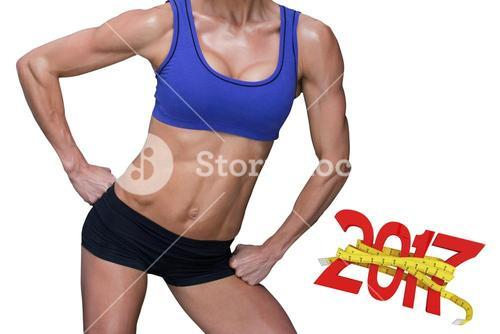 3D Composite image of midsection of fit woman in sportswear