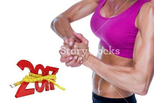 3D Composite image of female bodybuilder posing with hands together