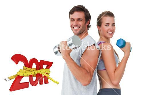 3D Composite image of portrait of a fit couple exercising with dumbbell