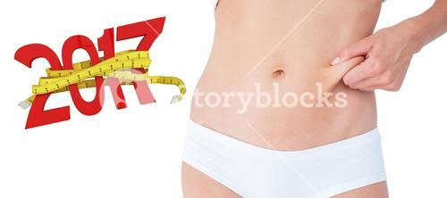 3D Composite image of woman posing without any fat on her belly