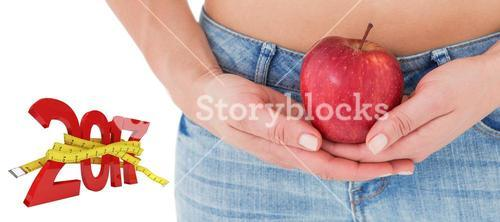 3D Composite image of fit woman standing with red apple