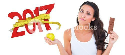 3D Composite image of pretty brunette deciding between apple and chocolate
