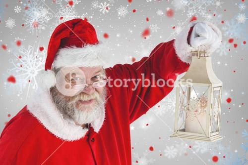 Composite image of portrait of santa claus holding christmas lantern