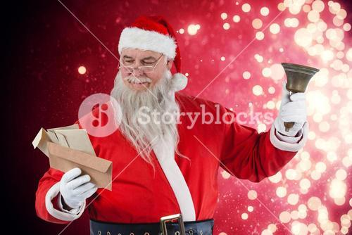 Composite image of santa claus reading envelope with bell
