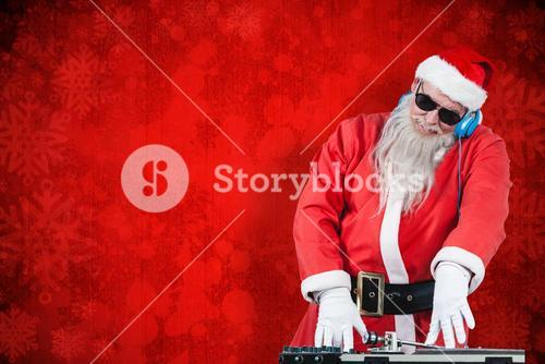 Composite image of dj santa claus mixing sound