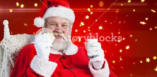 Composite image of santa claus holding glass of milk and cookie