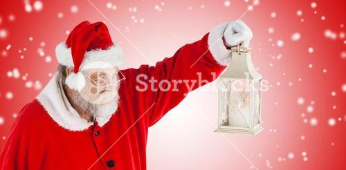 Composite image of santa claus looking at christmas lantern