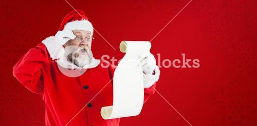 Composite image of santa claus making facial expression while reading scroll