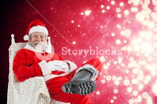 Composite image of cheerful santa claus relaxing on chair