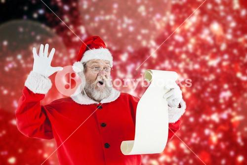 Composite image of surprised santa claus making face while reading scroll