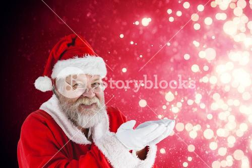 Composite image of santa claus with hands cupped