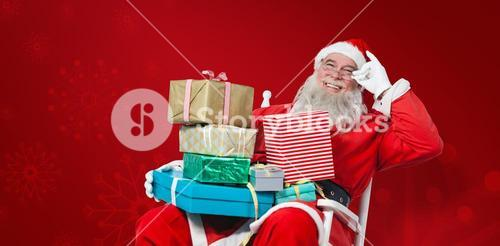 Composite image of cheerful santa claus holding chritmas presents while sitting on chair