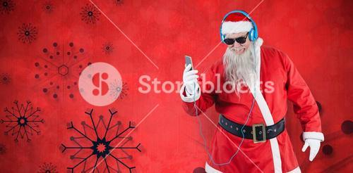 Composite image of santa claus listening to music on mobile phones