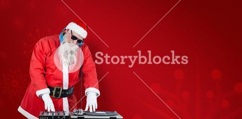 Composite image of santa claus playing dj
