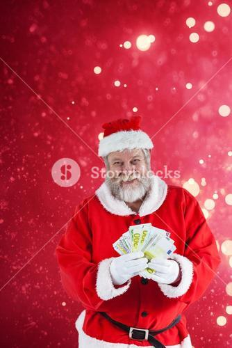 Composite image of santa claus showing currency notes