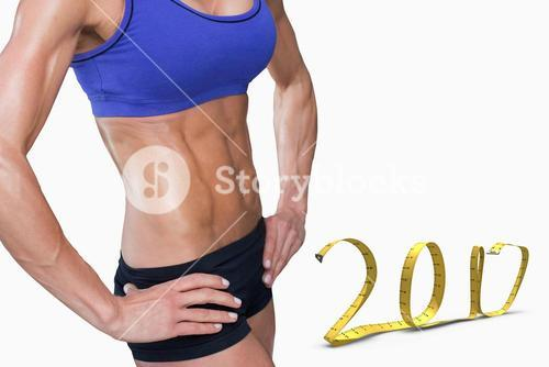 3D Composite image of midsection of fit woman with hand on hip