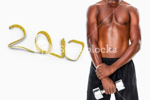 3D Composite image of mid section of fit shirtless man holding dumbbell