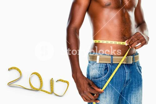 3D Composite image of mid section of a fit shirtless man measuring waist