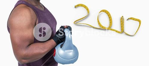 3D Composite image of fit man exercising with kettlebell