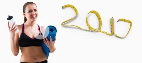 3D Composite image of fit brunette holding mat and sports bottle