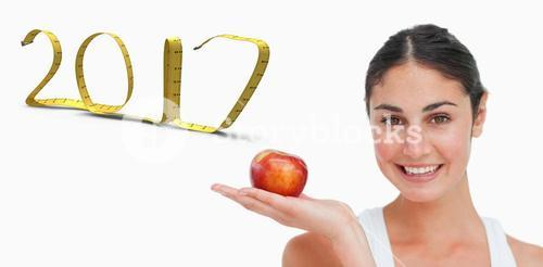 3D Composite image of woman on diet with an apple in the hand