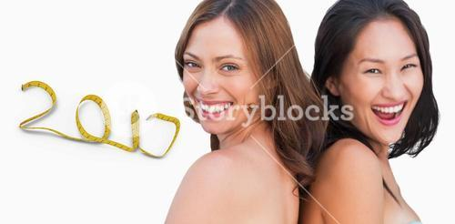 3D Composite image of laughing beautiful nude models posing back-to-back