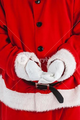 Composite image of midsection of santa claus with hands cupped