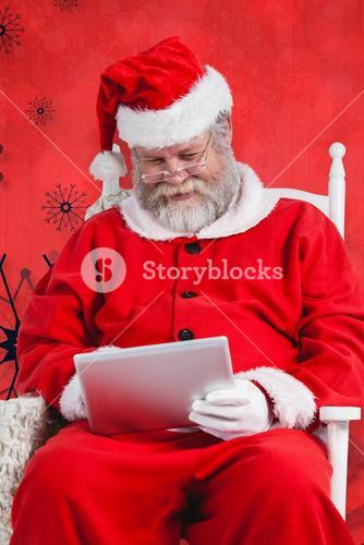Composite image of santa claus playing games on digital tablet
