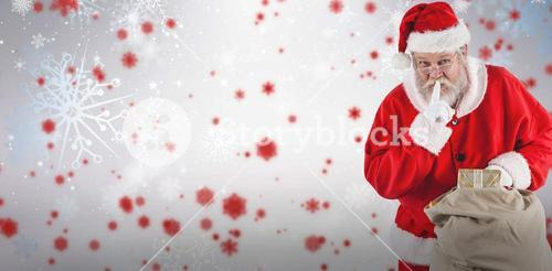 Composite image of santa claus with finger on lips and holding gifts