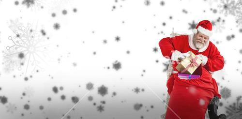 Composite image of santa claus removing presents from christmas bag