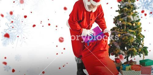 Composite image of santa claus packing christmas bag