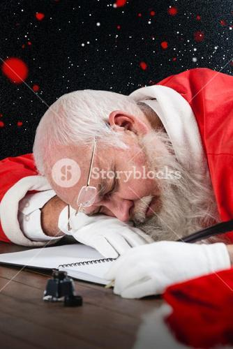 Composite image of tired santa claus napping at desk while writing a letter with a quill